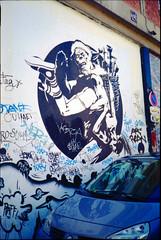 (busy.pochi) Tags: streetart paris film analog 35mm graffiti minolta 135 agfa spanking lubna spank argentique 100iso agfavista pellicule  liberatore  24x36   ranxerox fesse  minoltahimaticg2 taninoliberatore