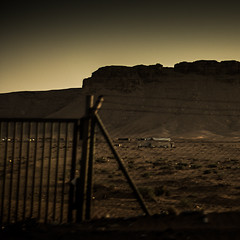 Desert Fence (The Paul Miller) Tags: from sunset summer sun car zeiss speed fence photography wire sand nikon village desert drought heat saudi arabia barbed wasteland vast d5100 vision:mountain=078 vision:sunset=0897 vision:ocean=0538 vision:plant=0607 vision:sky=099 vision:clouds=0961 vision:outdoor=0848