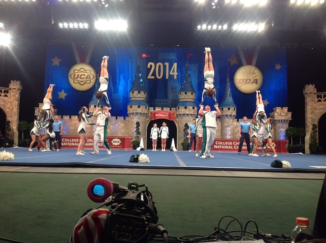 The 2014 cheerleading team competing at the 2014 UCA/UDA College Cheerleading and
