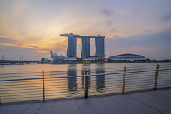 Singapore landmark city skyline at the Marina bay during sunset dusk. (MEzairi) Tags: architecture asia attraction bay building business city cityscape culture downtown dusk famous fountain hotel landmark lion marina modern morning night park reflection river sea singapore sky skyline skyscraper sunrise sunset symbol tourism tower travel urban view water waterfront