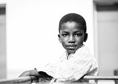 Black on white street portrait (Giulio Magnifico) Tags: portrait black blackwhite kid streetphotography udine nikond800 nikkormicro105mmafsvrf28