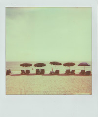 Sittin on the beach (Jacob's Camera Closet) Tags: camera sun film beach polaroid 600 instant