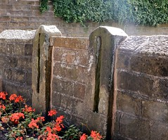 Wickersley old stocks in the wall round the War Memorial (Cardedfolderol) Tags: yorkshire stocks historical rotherham southyorkshire localhistory wickersley