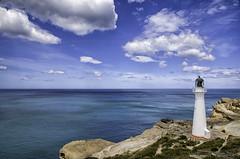 Castlepoint lighthouse, Wellington, New Zealand, Jan 2013 (Clia Mendes Photography) Tags: ocean blue newzealand sky azul clouds landscape mar lighthouses seascapes paisaje paisagem cu cielo nubes nuvens oceano novazelndia faros nuevazelanda faris paisajemartimo 2013 paisagemmartima