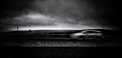 . . . driving away from home (orangecapri) Tags: auto road blackandwhite blur car speed mono movement automobile driving vehicle dramaticsky movingcar motoramic orangecapri