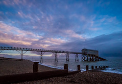 Selsey Beach (Simon Giddings) Tags: ocean uk pink blue winter sunset sea england sky sun sunlight hot cold beach nature water sunshine evening solar pier boat warm bright westsussex unitedkingdom january lifeboat boathouse selsey chichester