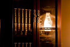 Reflecting on the Past 1 (LongInt57) Tags: lighting red brown white black glass leather reflections gold lights reflecting warm doors furniture books ornaments lanterns glowing lamps bookcase brass shelves encyclopedia encyclopaedia