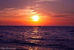 A Perfect Mediterranean Sunset (2) (BlueLunarRose) Tags: blue sunset red sea sky orange cloud sun sunlight seascape water colors yellow sparkles glitter clouds skyscape landscape boat twilight mediterranean sailing purple horizon sail waterscape waterspace sonyalphadslra200 suntwilight bluelunarrose sal1855
