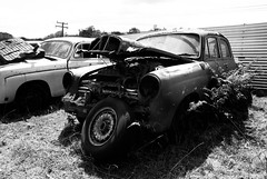 spare (Burnt Out Chevrolet) Tags: new old light sky bw white 3 black classic broken window lamp beauty grass car wheel metal yard vintage germany point island star mercedes benz three cool rust exposure paint skies open body head sony north central over bleach tire expose retro grill dirt zealand fender german nz waikato vehicle motor spare grille windshield elegant alpha a200 bonnet majestic windscreen timer scrap salvage defeat tirau bnw tyre pointed merc spares mercworx