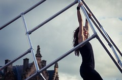 Holding a breath (elizunseelie) Tags: street city blue summer sky urban woman house motion building beauty festival metal female clouds photoshop buildings scotland dance athletic cool holding dancing pentax body glasgow air performance july blues scottish curls cage dancer grace blacks scaffold hanging express form suspended brunette tamron tones fragile graceful merchant hold k5 lightroom