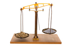 Gold and silver on a balance (Tibanna79) Tags: scales balance gold silver preciousmetals business goldprice scale precious weigh investmenttrading finance compare concept stockexchange rate nuggets heap rise increasing expensive falling background isolated preciousmetal