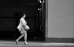 Crossed Walker (burnt dirt) Tags: houston texas downtown city town street sidewalk streetphotography office building wall crosswalk fujifilm xt1 bw blackandwhite girl woman people person garage parkinggarage asian walking purse bag officeworker ponytail heels stilettos keys lights