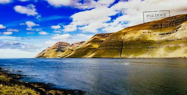 A man fishing in the fjord of Kunoy (panorama) - Faroe Islands
