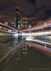 When life hands you puddles... Splash in 'em! (Paul Scearce) Tags: seattle skyscrapers washington nightphotography puddlereflection reflection nightlights longexposure lighttrails downtown nikon d5500