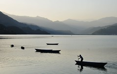 Lakeside in Pokhara.... (Rosanna Leung...away for 2 weeks) Tags: nepal people mountain lake silhouette boat dusk lakeside  pokhara    phewalake     fewalake     annapurnaarea