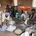 A woman and man process corn using the Multifunctional Platform Engine in Burkina Faso