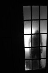 Becoming a Shade (Kmfresh) Tags: shadow white black silhouette eerie doorway shade ghoul greyscale photog