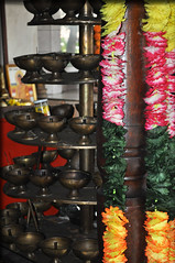 Hindu Temple in Mauritius - Grand Bassin (littlestschnauzer) Tags: travel flowers bronze island temple nikon tour south culture grand august cups sacred waters inside mauritius hindu hinduism stacked upwards bassin religeon 2013 d5000 elementsorganizer11