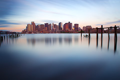 Boston Skyline just after Sunrise, Carlton's Wharf East Boston (Greg DuBois Photography) Tags: ocean lighting old city longexposure morning light sea sky urban usa seascape color reflection building history water glass colors boston skyline architecture clouds skyscraper sunrise canon buildings photography harbor pier early seaside cool movement warm cityscape skyscrapers unitedstates decay massachusetts tide smooth shoreline newengland atlantic financialdistrict glossy le shore wharf nd gloss pilings piling northend dilapidated waterway glassy cityskyline bostonskyline eastboston bostonharbor ndfilter carltonswharf carltonwharf gregdubois gregduboisphotography
