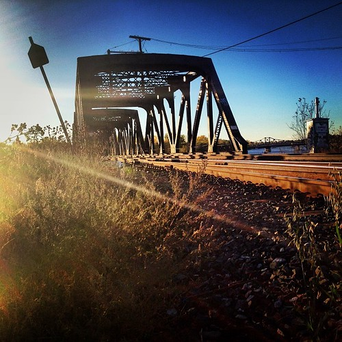 Abridged #tracks #train #sunlight #river #redriver #louisebridge #stones #bright #winnipeg