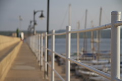 An evening in Fornells (judi may) Tags: boats evening dof bokeh harbour lamps railings menorca fornells eveninglight harbourwall
