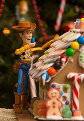 Woody Attacking the Gingerbread House (Tolga Cetin Photography) Tags: christmas xmas red house holiday cute cane children buzz toy mms cowboy funny holidays candy gingerbread woody disney story pixar icing