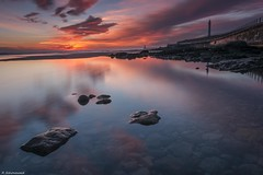 More Seaburn reflections (rickyschonewald) Tags: uk lighthouse seascape reflection water clouds sunrise pier rocks seawall northsea northeast sunderland rockpools seaburn ndfilters gradfilter cloudreflection nikond3100 vision:mountain=0631 vision:sunset=0893 vision:sky=0945 vision:ocean=0773 vision:outdoor=0766 vision:clouds=0932