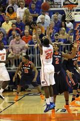 Michael Frazier II made Three Point Jumper. Assisted by DeVon Walker (dbadair) Tags: basketball war university eagle florida gators auburn tigers sec uf 2014