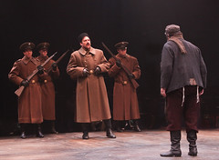 "Aaron Serotsky and Bob Amaral as Constable and Tevye, with Russian military Andrew J. Perez, Benjamin Gibson and Joseph Lewis in the Music Circus production of ""Fiddler on the Roof"" at the Wells Fargo Pavilion Aug 14-19. Photo by Charr Crail."