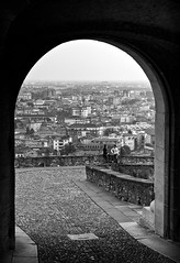 Bergamo through S.Giacomo gate (Jacopo.Colombo) Tags: urban blackandwhite bw landscape eos blackwhite gate citylandscape bergamo paesaggiourbano 50mmf12 bergamoalta canon50mmf12 cittàdeimille upperbergamo canoneos60d portasgiacomo eos60d mygearandme