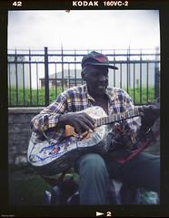 Farewell to Guelph's Sam the Guitar Man (BunnySafari) Tags: holga rip guitarist plasticcamera 2010 kodak160vc fpp downtownguelph downtownguelphicon guelphicon