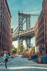on the hunt among giants (nathan camarillo) Tags: street new york city nyc bridge ny architecture construction nikon photographer manhattan dumbo d90 urbran