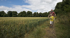 Catch Me if You Can! (Amor Lucis) Tags: ireland summer green field landscape fun sam wheat tripod games crop fields crops setup chasing kildare celbridge castletownhouse remotetrigger fieldsofwheat nikonafsnikkor1635mm davidcaulfiield northernkildare afsnikkor1635