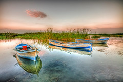 Sunrise boats (Nejdet Duzen) Tags: trip travel lake reflection sunrise turkey boat trkiye sandal gnbatm gl yansma turkei manisa glmarmara seyaht