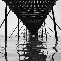 vanishing point (mujepa) Tags: sea bw beach monochrome lines pier vanishingpoint wooden perspective greece corfu grèce bois lignes corfou pointdefuite mygearandme mygearandmepremium mygearandmebronze blinkagain jetey pierxperspectivexwoodenxbeachxseaxjetéexboisxplagexmerxvanishing