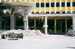 Miami Herald Demolition (Phillip Pessar) Tags: camera building film architecture analog 35mm fuji florida zoom miami infinity olympus demolition mimi 200 70 herald midcentury c41