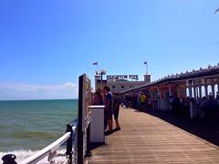 Take me back to summer... brighton pier (MaykoLorena) Tags: ocean uk blue sea england sky birds clouds pier brighton unitedkingdom brightonpier brightonseafront