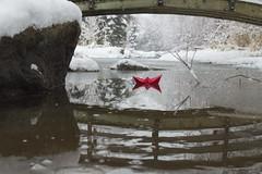 Paper Boat Under Winter Bridge (aaronrhawkins) Tags: boat origami bridge winter stream river provo utah snow ice reflection rock red scene january cold freeze frozen water pond storm float aaronhawkins