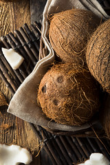 Raw Organic Tropical Brown Coconuts (brent.hofacker) Tags: background break broken brown coco coconut coconuts cracked cut delicious diet dieting exotic food fresh freshness fruit gourmet half hard health healthy husk ingredient liquid milk natural nature nut nutrition object open organic palm plant round shell summer sweet tasty tropical vegan vegetarian vitamin white wooden