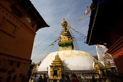 My Neighbors Are Stupa (Universal Stopping Point) Tags: nepal stain buildings temple stupa buddhist peekaboo prayer flags kathmandu saffron monkeytemple