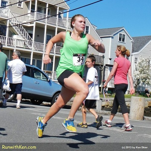 LEAPING to the finish line!  Runners at the Motif #1 5K in Rockport, MA.
