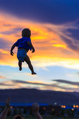 Soaring (Barrett Farmer) Tags: park sunset sky baby mountains fall clouds fly flying toddler floating diaper falling catch soaring float throw soar thrown