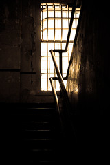 Stairway to Hell (IM_1251) Tags: sanfrancisco windows light building history window metal architecture bar stairs dark island bars stair escape stuck captured prison criminal staircase jail alcatraz desaturated walls prisoner penitentiary confinement