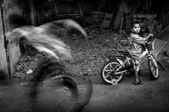 a kid on a bicycle (Kristoff Documentary Photographer) Tags: poverty street boy bicycle yellow kid asia cambodia poor phnom penh