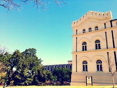 A Castle at the Capitol (Cesar's iPhoneography) Tags: cameraphone blue trees windows shadow sky sun sunlight building tree brick green castle window public grass leaves yellow stone skyline museum architecture facade austin landscape outside outdoors daylight scenery downtown day branch texas afternoon open view state bright path branches capital entrance naturallight ground bluesky scene clear capitol shade government skyward fortress legislature gnarled whitewashed iphone texascapitol texasstatecapitol lonestarstate texascapital iphoneography
