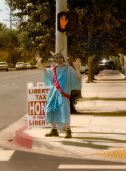 Liberty (Fire Monkey Fish) Tags: california sign corner losangeles time tax sfv sanfernandovalley advertisment reseda twirler liverty adamjrough