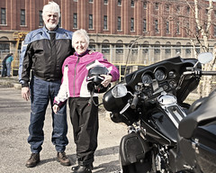 Frank & Marcia (local paparazzi (isthmusportrait.com)) Tags: pink portrait black detail building classic bike architecture canon frank outdoors happy eos 50mm prime iso200 pod couple shiny raw boots dam f14 helmet johnson strangers adorable mirrors marcia clarity environmental sunny 8x10 harley hydro chrome dash portraiture harleydavidson fancy motorcycle cropped desaturated usm gps bluejeans joyful gears speedometer brightness ef welch bikers hydroelectric ignition 2014 sharpness canonraw motorcyclejacket cr2 niceday newcomer canon50mmf14usm environmentalportraiture 50mmf14usm alliantenergy saturdayride 100strangers photoshopelements7 canon5dmarkii pse7 saukcountywisconsin lopaps prairiedusacwi 100morestrangers