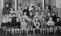 Class photo (theirhistory) Tags: uk school girls boys children hall photo shoes dress boots sandals group skirt class teacher junior gb shorts primary