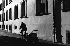 Caring Carrying (Thomas Listl) Tags: thomaslistl blackandwhite noiretblanc biancoenegro light shadow silhouette bike windows street urban road