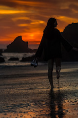 Malibu Beach Shoes (Wilkof Photography) Tags: elmatadorbeach malibu beach beachfront boulder rockformation rocky cliff cliffside canon cloudy losangeles california colorful dark dusk dof evening golden girl woman silhouette profile lowangle lowlight horizon landscape light land 70200mm 115mm lens portrait mountains nature natural night overcast outside ocean oceanfront oceanscape orange perspective pacificocean reflection rocks shadow scenic sky sunset serene sand sea sundown seascape shoes surf shore shoreline sandy sunlit water wet wilkofphotography
